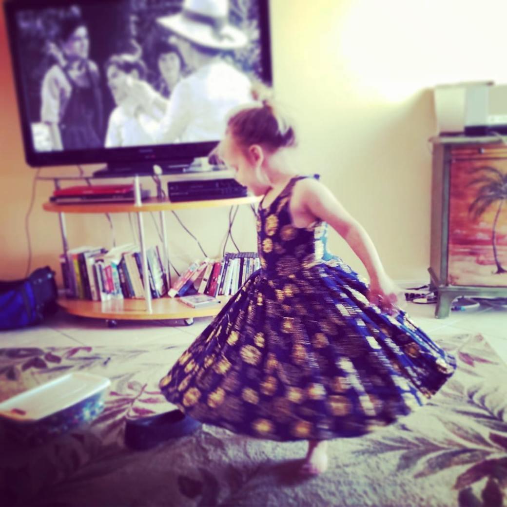 rose in handmade dress
